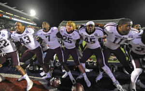 Photo -   Texas A&M players sing their fight song as they celebrate a 30-27 win over Mississippi in an NCAA college football game in Oxford, Miss., Saturday, Oct. 6, 2012. (AP Photo/The Daily Mississippian, Austin McAfee) MANDATORY CREDIT