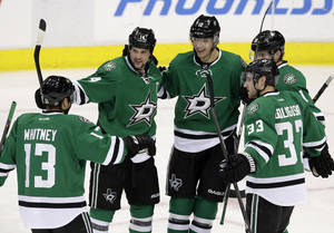 Photo - Dallas Stars' Ray Whitney (13), Jamie Benn, Alex Goligoski (33) and Tyler Seguin (91) celebrate with Alex Chiasson (12) following Chiasson's goal in the second period of an NHL hockey game against the Nashville Predators, Friday, March 28, 2014, in Dallas. (AP Photo/Tony Gutierrez)