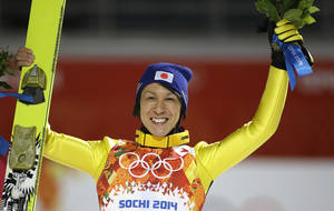 Photo - Japan's Noriaki Kasai celebrates winning the silver after the ski jumping large hill final at the 2014 Winter Olympics, Saturday, Feb. 15, 2014, in Krasnaya Polyana, Russia. (AP Photo/Gregorio Borgia)
