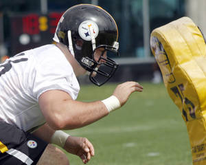 photo -   Pittsburgh Steelers number one draft choice, David DeCastro, an offensive guard from Stanford, does a blocking drill during the NFL football team&#039;s rookie minicamp at their facility in Pittsburgh on Friday, May 4, 2012. (AP Photo/Keith Srakocic)  