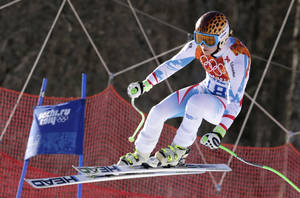 Photo - Austria's Anna Fenninger makes a jump in the women's super-G at the Sochi 2014 Winter Olympics, Saturday, Feb. 15, 2014, in Krasnaya Polyana, Russia. (AP Photo/Charles Krupa)