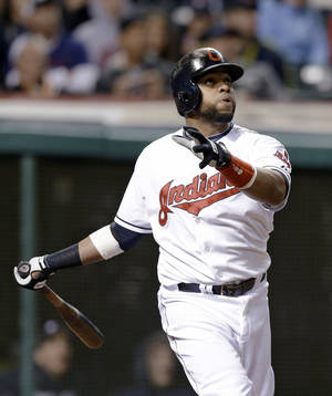 Cleveland Indians' Carlos Santana watches his two-run home run off Toronto Blue Jays starting pitcher Drew Hutchison during the sixth inning of a baseball game, Friday, April 18, 2014, in Cleveland. (AP Photo/Tony Dejak)