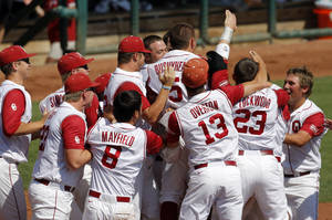 Photo - Oklahoma celebrates their win over Oklahoma State during the Big 12 baseball tournament game between Oklahoma State University and the University of Oklahoma at the Chickasaw Bricktown Ballpark in Oklahoma City,  Wednesday, May 23, 2012. Photo by Sarah Phipps, The Oklahoman.