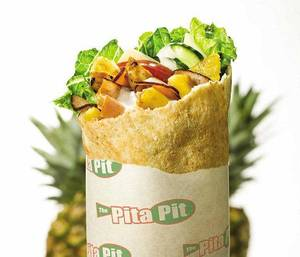 Photo - This Light Aloha pita from Pita Pit is among healthy options restaurants are offering customers in the new year. PHOTO PROVIDED