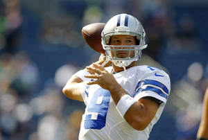 photo -   Dallas Cowboys quarterback Tony Romo throws in warm ups before an NFL football game against the Seattle Seahawks, Sunday, Sept. 16, 2012, in Seattle. (AP Photo/John Froschauer)
