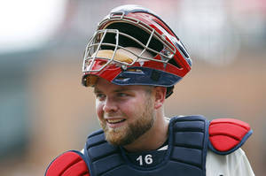 Photo - FILE - In this July 15, 2012, file photo, Atlanta Braves catcher Brian McCann looks on during a baseball game against the New York Mets in Atlanta. A person familiar with the negotiations tells The Associated Press that free-agent McCann and the New York Yankees are about to close a five-year deal for about $85 million. The person spoke Saturday night, Nov. 23, 2013, on condition of anonymity because the deal was not complete. (AP Photo/John Bazemore, File)