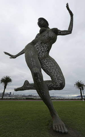 "Photo - Cloudy skies embrace the art sculpture ""Bliss Dance"" as unsettled weather moves into the Bay Area Sunday, Jan. 6, 2013, seen from Treasure Island in San Francisco Bay.   The National Weather Service says thunderstorms were in the forecast Sunday for the San Mateo and Monterey County coasts, with lightning strikes reported early Sunday. (AP Photo/Ben Margot)"