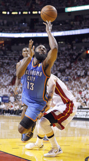 Photo - Oklahoma City's James Harden drives to the basket as Miami's Mike Miller, back, defends during Game 5 of the NBA Finals on Thursday at American Airlines Arena.  Photo by  Bryan Terry,  The Oklahoman