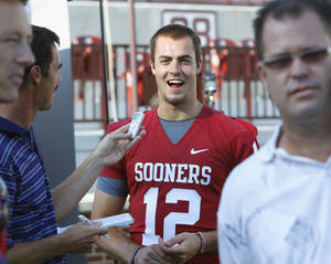 photo - OU quarterback Landry Jones talks with the media on Friday in Norman. PHOTO BY STEVE SISNEY, THE OKLAHOMAN