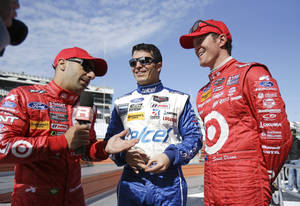 Photo - Tony Kanaan, left, of Brazil, interviews Memo Rojas, center, of Mexico, and Scott Dixon, of New Zealand after a practice for the IMSA Series Rolex 24 hour auto race at Daytona International Speedway in Daytona Beach, Fla., Friday, Jan. 24, 2014. (AP Photo/John Raoux)
