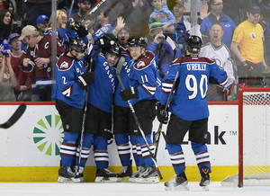 Photo - Colorado Avalanche defenseman Andre Benoit, second from left, is congratulated by teammates Nick Holden (2), John Mitchell, center, Jamie McGinn (11) and Ryan O'Reilly (90) after scoring a goal against the New York Rangers during the second period of an NHL hockey game on Thursday, April 3, 2014, in Denver. (AP Photo/Jack Dempsey)