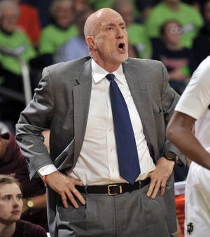 Photo - Virginia Tech coach Dennis Wolff shouts instructions to his team during the first half of an NCAA college basketball game against Notre Dame, Thursday, Jan. 30, 2014 in South Bend, Ind. (AP Photo/Joe Raymond)