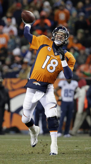 Photo - Denver Broncos quarterback Peyton Manning throws against the Tennessee Titans during the second half of an NFL football game on Sunday, Dec. 8, 2013, in Denver. (AP Photo/Jack Dempsey)