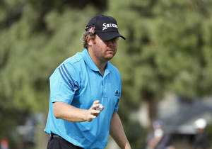 Photo - William McGirt reacts after he made birdie on the first hole in the third round of the Northern Trust Open golf tournament at Riviera Country Club in the Pacific Palisades area of Los Angeles, Saturday, Feb. 15, 2014. (AP Photo/Reed Saxon)