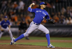 Photo - Toronto Blue Jays starting pitcher Esmil Rogers throws to the Baltimore Orioles in the first inning of a baseball game on Wednesday, Sept. 25, 2013, in Baltimore. (AP Photo/Patrick Semansky)