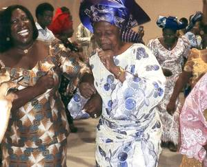 Photo - Women dance at the 2011 African Christian Fellowship Praise Party at Riverside Church in Norman. Photo provided <strong>Prepress</strong>