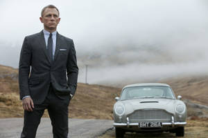 "Photo - FILE - This undated handout file photo released by Columbia Pictures shows Daniel Craig as James Bond in the action adventure film, ""Skyfall."" According to studio estimates Sunday, Dec. 9, 2012, ""Skyfall"" took in $11 million to move back to No. 1 in its fifth weekend. That puts it narrowly ahead of ""Rise of the Guardians,"" the animated adventure of Santa, the Easter Bunny and other mythological heroes that pulled in $10.5 million.(AP Photo/Sony Pictures, Francois Duhamel, File)"