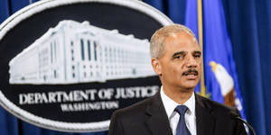 Photo - WASHINGTON, DC - SEPTEMBER 30:  U.S. Attorney General Eric Holder speaks during a press conference announcing Department of Justice plans to sue North Carolina over Voter ID regulations at the Department of Justice on September 30, 2013 in Washington, DC. Under the new law North Carolina residents are required to show a photo ID at polling places which some believe threatens the voting rights of minorities.   (Photo by Kris Connor/Getty Images)