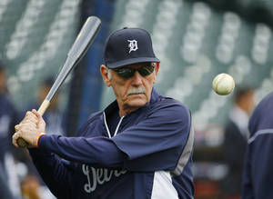Photo - Detroit Tigers manager Jim Leyland hits during fielding practice before Game 3 of the American League baseball championship series against the Boston Red Sox Tuesday, Oct. 15, 2013, in Detroit. (AP Photo/Paul Sancya) <strong>Paul Sancya</strong>