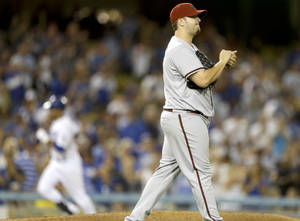 Photo -   Arizona Diamondbacks relief pitcher Matt Albers, right, looks away after giving up a home run to Los Angeles Dodgers' Andre Ethier during the sixth inning of a baseball game in Los Angeles, Saturday, Sept. 1, 2012. (AP Photo/Chris Carlson)