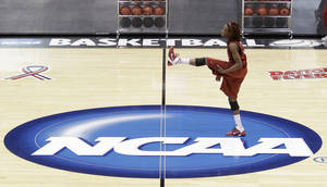 photo - Oklahoma guard Danielle Robinson loosens up during practice for an NCAA tournament regional semi-final basketball game, Friday, March 25, 2011 in Dayton, Ohio. Oklahoma plays Notre Dame Saturday. (AP Photo/Al Behrman)