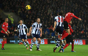 Photo - Cardiff City's Peter Whittingham, right, scores the opening goal against West Bromwich Albion with header, during their English Premier League soccer match at The Cardiff City Stadium, Cardiff, Wales, Saturday, Dec. 14, 2013. (AP Photo/Nick Potts, PA Wire)   UNITED KINGDOM OUT   -  NO SALES  -  NO ARCHIVES