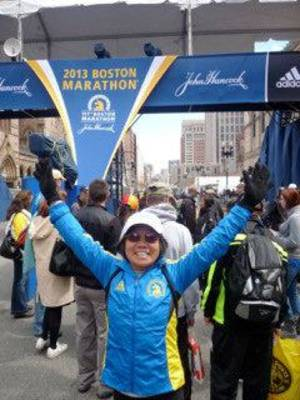 Photo - Chau Smith posing at the finish line, about 100 feet from where the first bomb went off, the day before the marathon. Photo provided <strong></strong>
