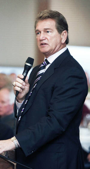Photo - Joe Theismann, former NFL star, speaks at the Bill Glass Breakfast of Champions event at the Petroleum Club in downtown Oklahoma City, OK, Friday, March 15, 2013,  By Paul Hellstern, The Oklahoman