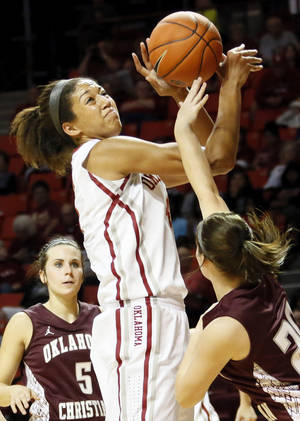 Photo - OU's Nicole Griffin (4) tries to get the ball past Oklahoma Christian's Kaitlyn Morris (20) during a women's college basketball exhibition game between the University of Oklahoma and Oklahoma Christian University at the Lloyd Noble Center in Norman, Okla., Thursday, Nov. 1, 2012. Photo by Nate Billings, The Oklahoman