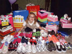 Photo - Bree Johnson, 7, asked for shoes for her birthday to donate to children in Africa. PHOTO PROVIDED <strong>Photo Provided</strong>