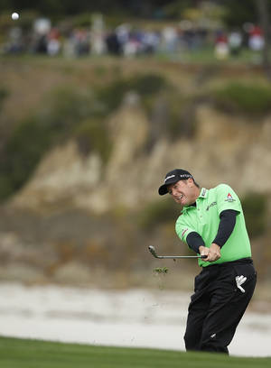 Photo - D.A. Points chips the ball up to the sixth green of the Pebble Beach Golf Links during the second round of the AT&T Pebble Beach Pro-Am golf tournament on Friday, Feb. 7, 2014, in Pebble Beach, Calif. (AP Photo/Eric Risberg)