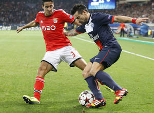 Photo - PSG's Ezequiel Lavezzi, right, dribbles Benfica's Andre Almeida during their Champions League group C soccer match between Paris Saint Germain and Benfica at Parc des Princes stadium, in Paris, Wednesday, Oct.2, 2013. (AP Photo/Francois Mori)