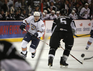 Photo - AHL HOCKEY: Oklahoma City's Ryan Nugent-Hopkins (18) takes a shot against San Antonio during a game between the Oklahoma City Barons and the San Antonio Rampage at the Cox Convention Center in Oklahoma City, Friday, Oct. 19, 2012.  Photo by Garett Fisbeck, The Oklahoman