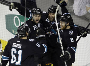 Photo - San Jose Sharks' Joe Pavelski (8) celebrates his goal with teammates during the third period of an NHL hockey game against the Winnipeg Jets on Thursday, Jan. 23, 2014, in San Jose, Calif. San Jose won 1-0. (AP Photo/Marcio Jose Sanchez)