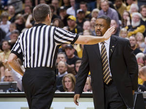 photo - Missouri coach Frank Haith, right, argues a call with a referee during the second half of an NCAA college basketball game against Texas A&M on Monday, Jan. 16, 2012, in Columbia, Mo. Missouri won the game 70-51. (AP Photo/L.G. Patterson) ORG XMIT: MOLG107
