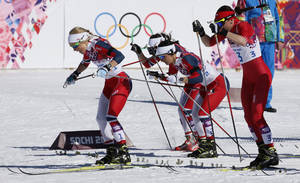 Photo - Norway's Therese Johaug, Norway's Marit Bjoergen and Poland's Justyna Kowalczyk, from left, start the women's 15k skiathlon at the 2014 Winter Olympics, Saturday, Feb. 8, 2014, in Krasnaya Polyana, Russia. (AP Photo/Dmitry Lovetsky)