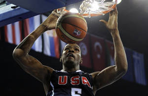 Photo - Team USA's Kevin Durant dunks the ball during Sunday's win over Slovenia. AP PHOTO
