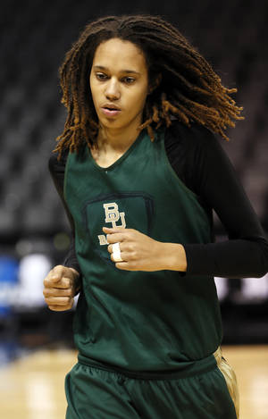 Photo - Baylor's Brittney Griner (42) warms up before practice during the press conference and practice day at the Oklahoma City Regional for the NCAA women's college basketball tournament at Chesapeake Energy Arena in Oklahoma City, Saturday, March 30, 2013. Photo by Nate Billings, The Oklahoman