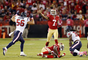 Photo - San Francisco 49ers quarterback Colin Kaepernick (7) throws a pass to Vernon Davis for a touchdown in the second half of an NFL football game against the Houston Texans in San Francisco, Sunday, Oct. 6, 2013. (AP Photo/Beck Diefenbach)