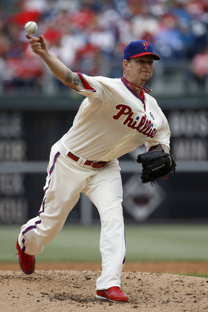 Photo - Philadelphia Phillies' A.J. Burnett pitches during the third inning of an interleague baseball game against the Los Angeles Angels, Wednesday, May 14, 2014, in Philadelphia. (AP Photo)