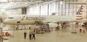 Photo - A new jet plane is prepared for use at the American Airlines operations center hanger in Grapevine, Texas. Airlines are on the largest jet buying spree in the history of aviation. AP Photo <strong>LM Otero</strong>
