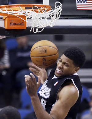 Photo - Sacramento Kings' Rudy Gay slams in two points in the first quarter of an NBA basketball game against the Minnesota Timberwolves, Wednesday, Jan. 15, 2014, in Minneapolis. (AP Photo/Jim Mone)