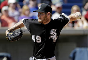 Photo - Chicago White Sox's Chris Sale throws during the fourth inning of an exhibition spring training baseball game against the Milwaukee Brewers, Monday, March 10, 2014, in Phoenix. (AP Photo/Morry Gash)