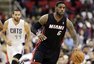 Photo -   Charlotte Bobcats' Jeffery Taylor (44) chases Miami Heat's LeBron James (6) during the second half of an NBA preseason basketball game in Raleigh, N.C., Tuesday, Oct. 23, 2012. Miami won 98-92. (AP Photo/Gerry Broome)