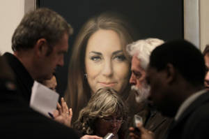Photo - Members of the media talk to artist Paul Emsley, center right, in front of his newly-commissioned portrait of Kate, Duchess of Cambridge, on display at the National Portrait Gallery in London, Friday, Jan. 11, 2013. (AP Photo/Sang Tan)
