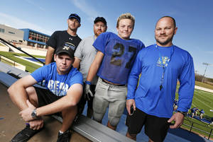 photo - Noble football assistant coaches Matt Lane, seated, Kyle Davidson, left, and Tyler Solomon, second from left, along with running back Jimmy Wood and head coach Steve Barrett, right, pose for a photo at the Noble High School football field in Noble, Okla., Wednesday, Oct. 31, 2012. Photo by Nate Billings, The Oklahoman