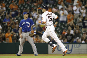 Photo - Houston Astros' Jason Castro (15) rounds the bases in front of Toronto Blue Jays third baseman Brett Lawrie on a solo home run in the seventh inning of a baseball game Saturday, Aug. 24, 2013, in Houston. (AP Photo/Pat Sullivan)