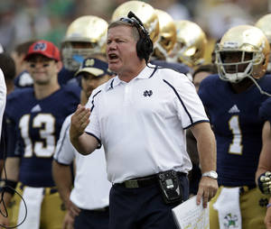 Photo - Notre Dame head coach Brian Kelly yells to his team during the second half of an NCAA college football game against Temple in South Bend, Ind., Saturday, Aug. 31, 2013. Notre Dame defeated Temple 28-6. (AP Photo/Michael Conroy)