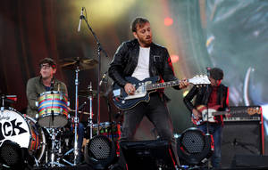 Photo -   FILE - In this Sept. 29, 2012 file photo, guitarist Dan Auerbach, center, and drummer Patrick Carney of The Black Keys perform at the Global Citizen Festival in Central Park, in New York. At the Austin City Limits Music Festival, about a third of the nearly 130 bands on a lineup that includes the Red Hot Chili Peppers, the Black Keys and Jack White will have their sets broadcast on YouTube. That's a record for the three-day festival that starts Friday, Oct. 12, 2012. (Photo by Evan Agostini/Invision/AP, File)