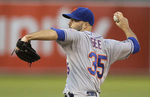 Photo - New York Mets' Dillon Gee pitches against the Oakland Athletics in the first inning of a baseball game Tuesday, Aug. 19, 2014, in Oakland, Calif. (AP Photo/Ben Margot)